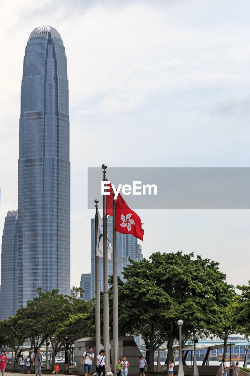 Hong kong flag against two international finance center in city
