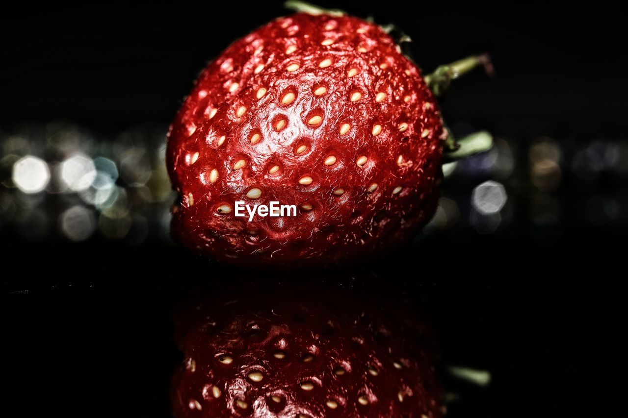 food and drink, red, close-up, fruit, food, freshness, healthy eating, focus on foreground, no people, wellbeing, indoors, berry fruit, strawberry, still life, ripe, selective focus, single object, night, raspberry, sweet food, temptation, lychee