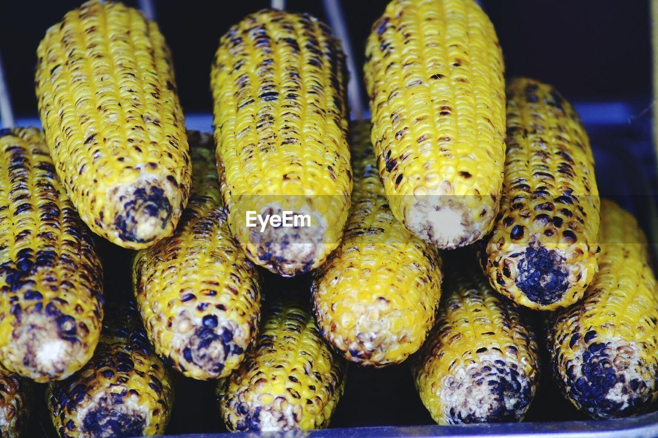 Close-Up Of Roasted Sweetcorns At Market