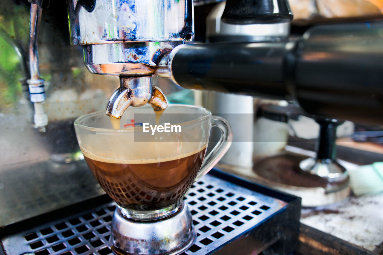 drink, coffee maker, coffee - drink, food and drink, coffee, appliance, machinery, refreshment, cafe, espresso maker, freshness, preparation, pouring, coffee cup, making, cup, coffee shop, close-up, indoors, glass, barista