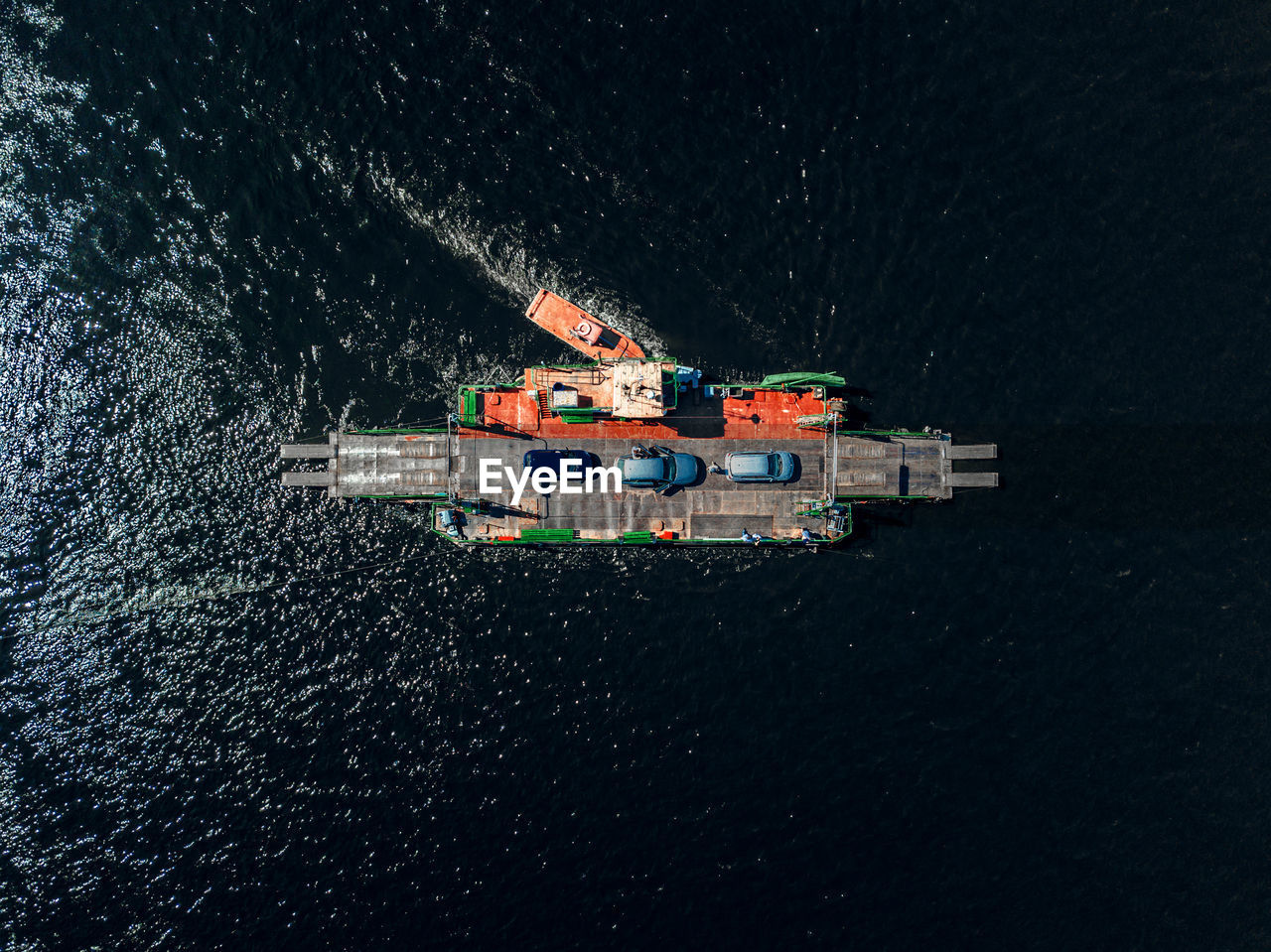 Aerial View Of Cars On Boat In Sea