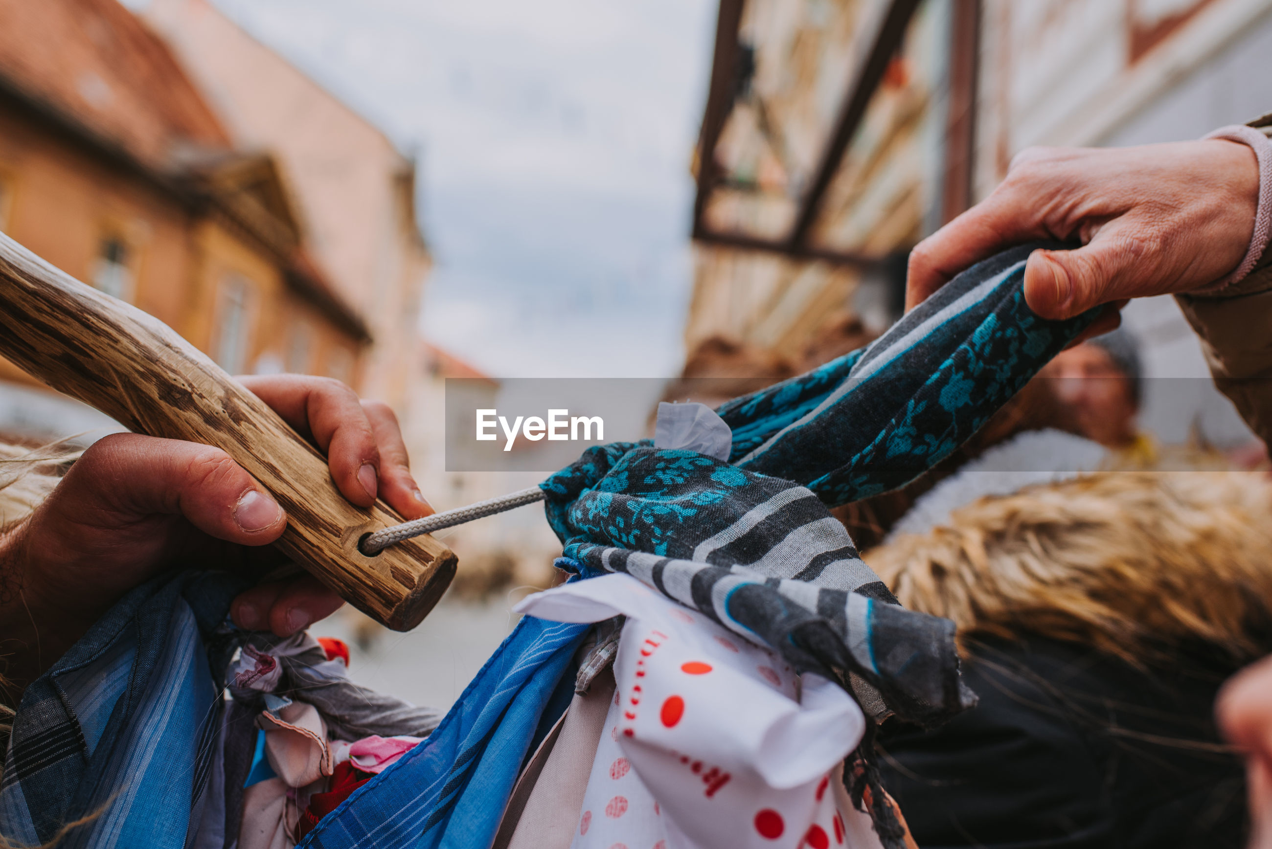 Cropped hand of people holding textile outdoor