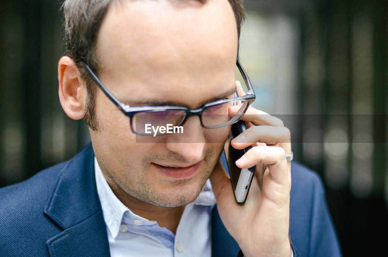 Portrait of mature man using mobile phone