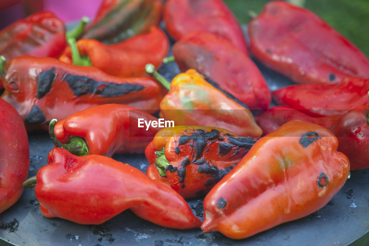 CLOSE-UP OF RED CHILI PEPPERS IN MARKET