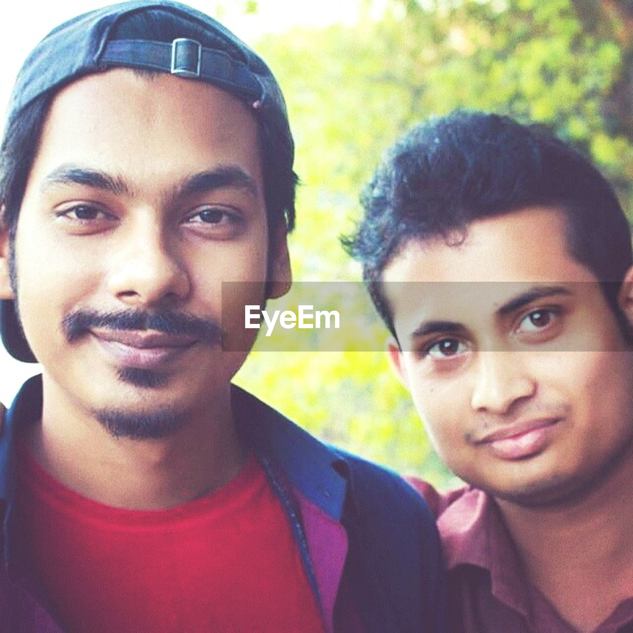 person, portrait, looking at camera, lifestyles, happiness, leisure activity, smiling, childhood, headshot, togetherness, boys, front view, elementary age, bonding, toothy smile, casual clothing, head and shoulders