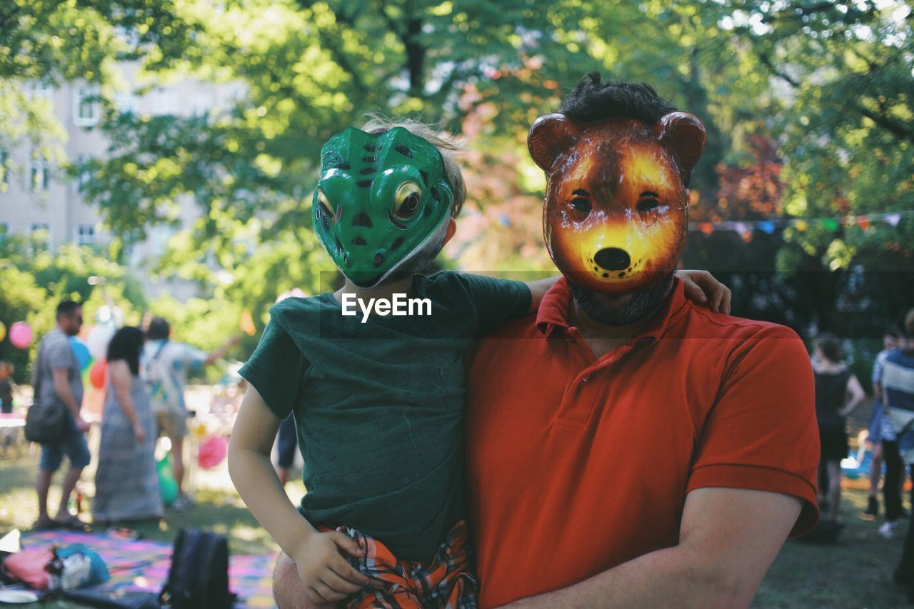 Father And Son Wearing Mask
