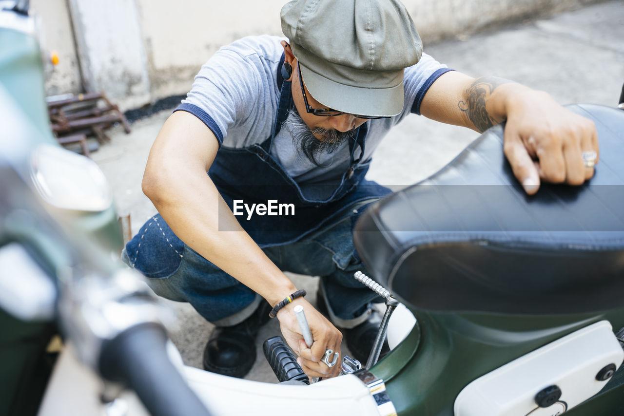 High angel view of mechanic working in garage