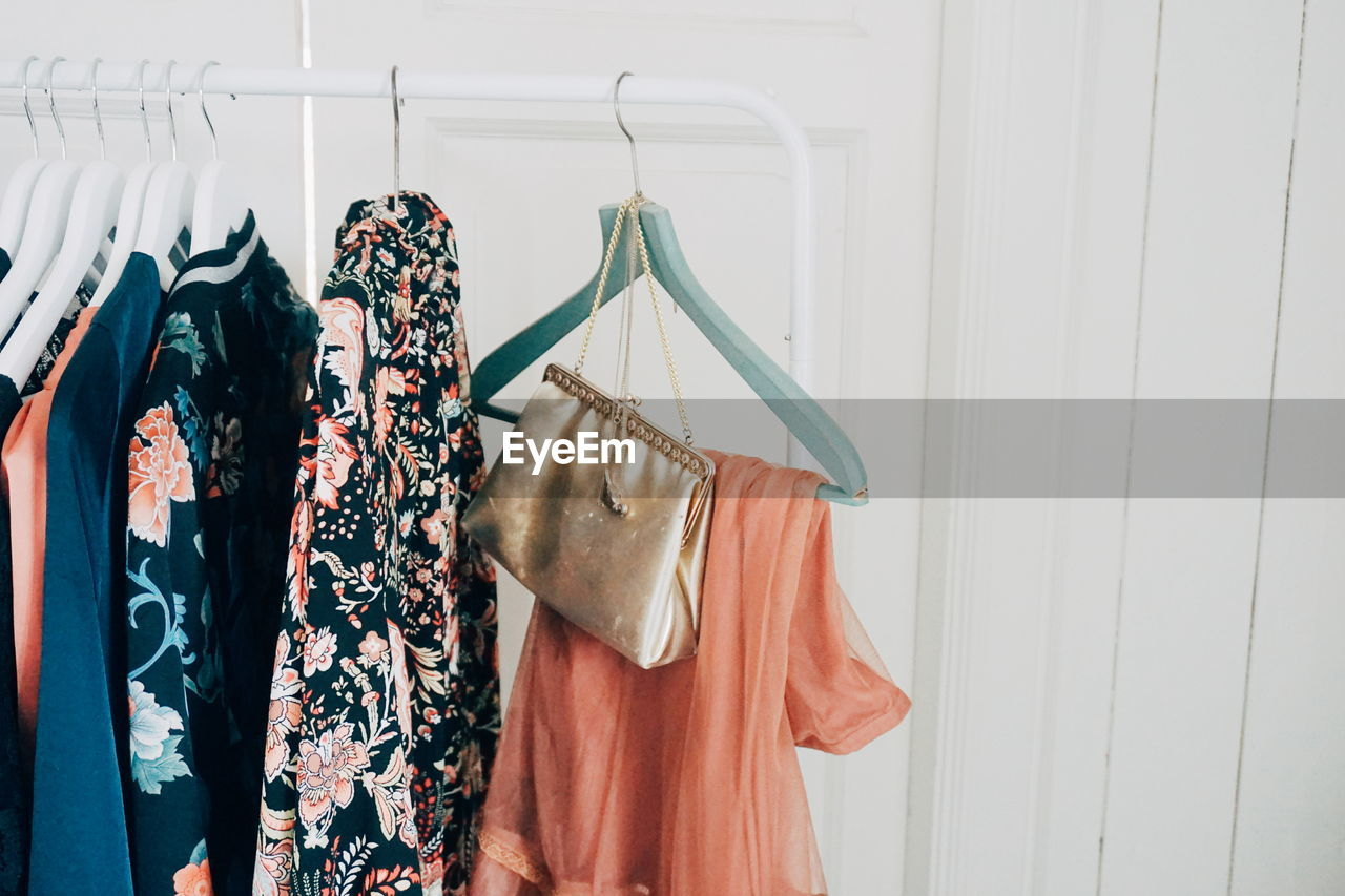 Close-Up Of Clothes Hanging On Rack At Home