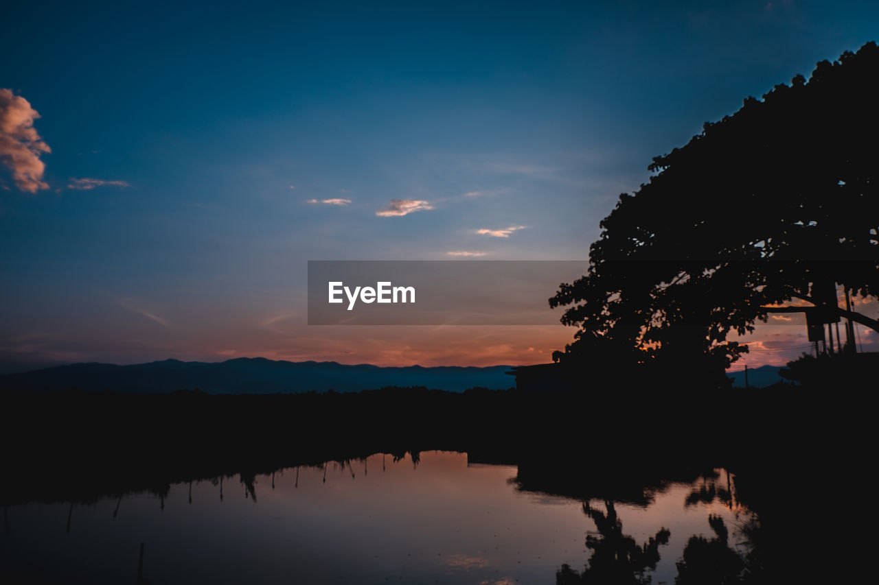 sky, sunset, reflection, silhouette, cloud - sky, water, beauty in nature, scenics - nature, tree, plant, tranquil scene, tranquility, nature, lake, orange color, no people, idyllic, waterfront, non-urban scene