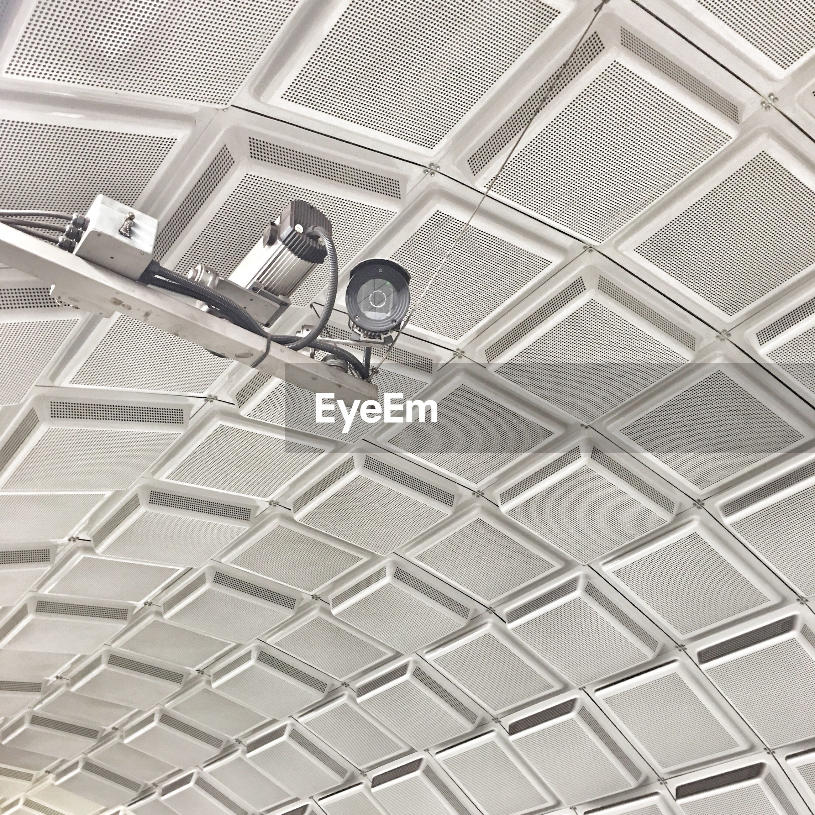 Low angle view of security cameras against ceiling