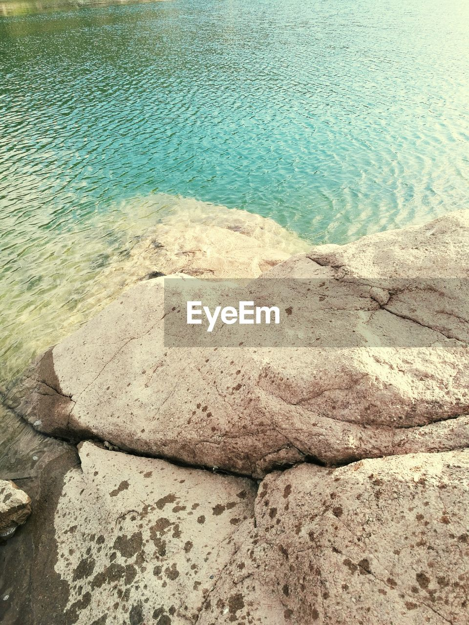 water, sea, tranquility, beauty in nature, nature, day, beach, tranquil scene, land, no people, rock, scenics - nature, solid, rock - object, high angle view, idyllic, outdoors, sand, non-urban scene, turquoise colored