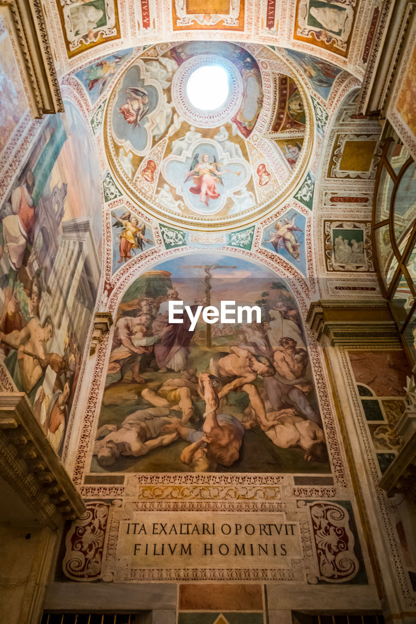 art and craft, religion, architecture, place of worship, belief, representation, text, spirituality, human representation, built structure, mural, indoors, ceiling, creativity, craft, male likeness, building, fresco, no people, cupola, ornate