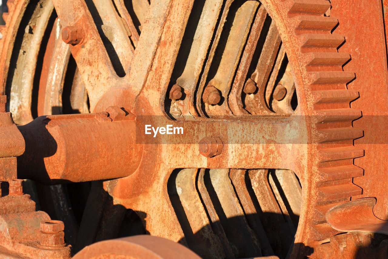 no people, metal, close-up, sunlight, pattern, day, brown, wood - material, backgrounds, full frame, textured, built structure, wall - building feature, architecture, wall, outdoors, old, rusty, creativity, wheel