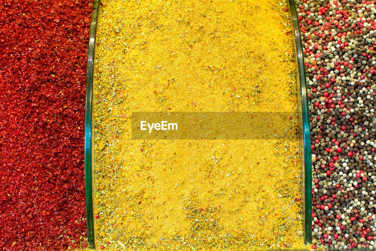 Directly above shot of spices for sale at market stall