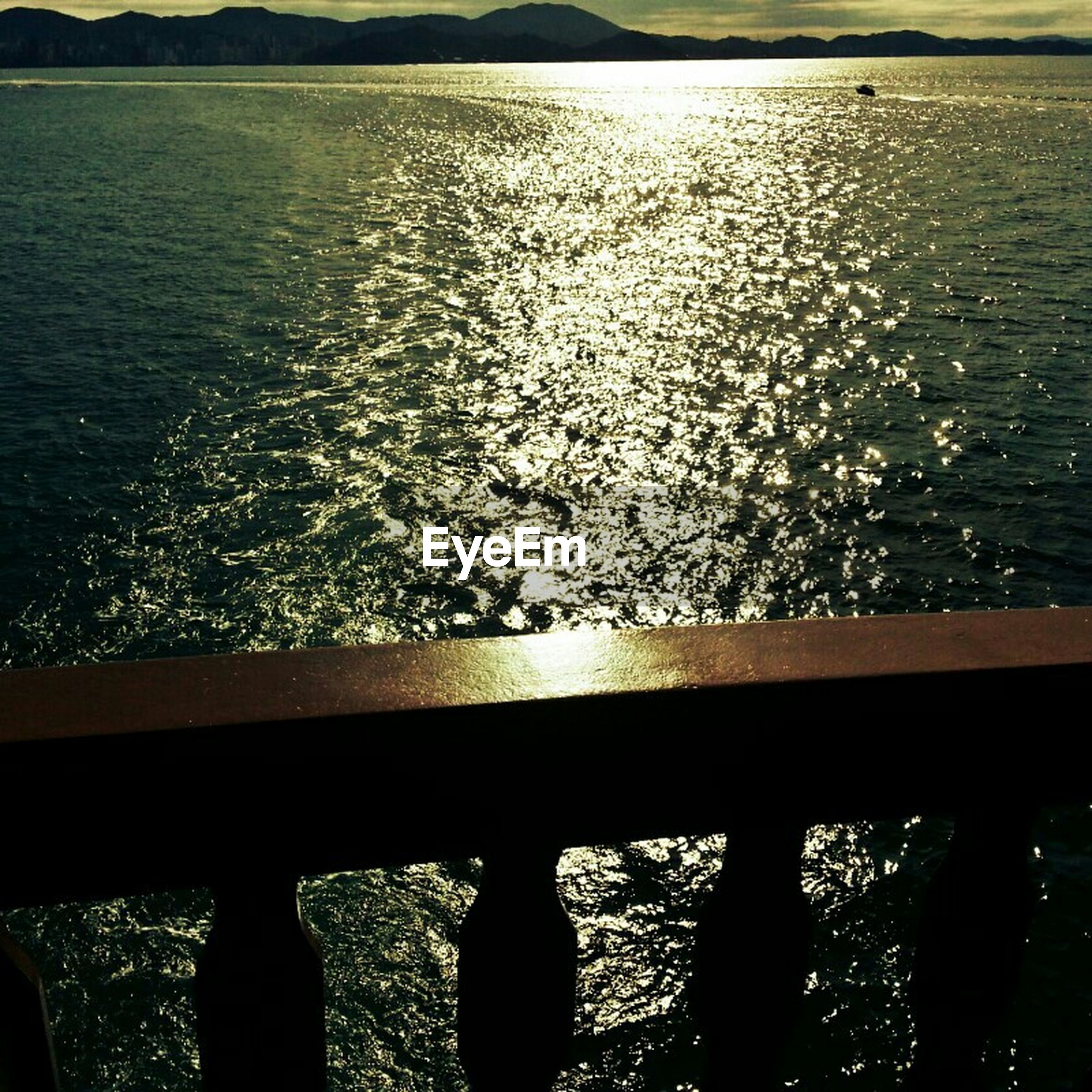 water, silhouette, rippled, sea, railing, beauty in nature, nature, sunset, reflection, tranquility, tranquil scene, scenics, lake, sunlight, river, high angle view, pier, outdoors, idyllic, no people