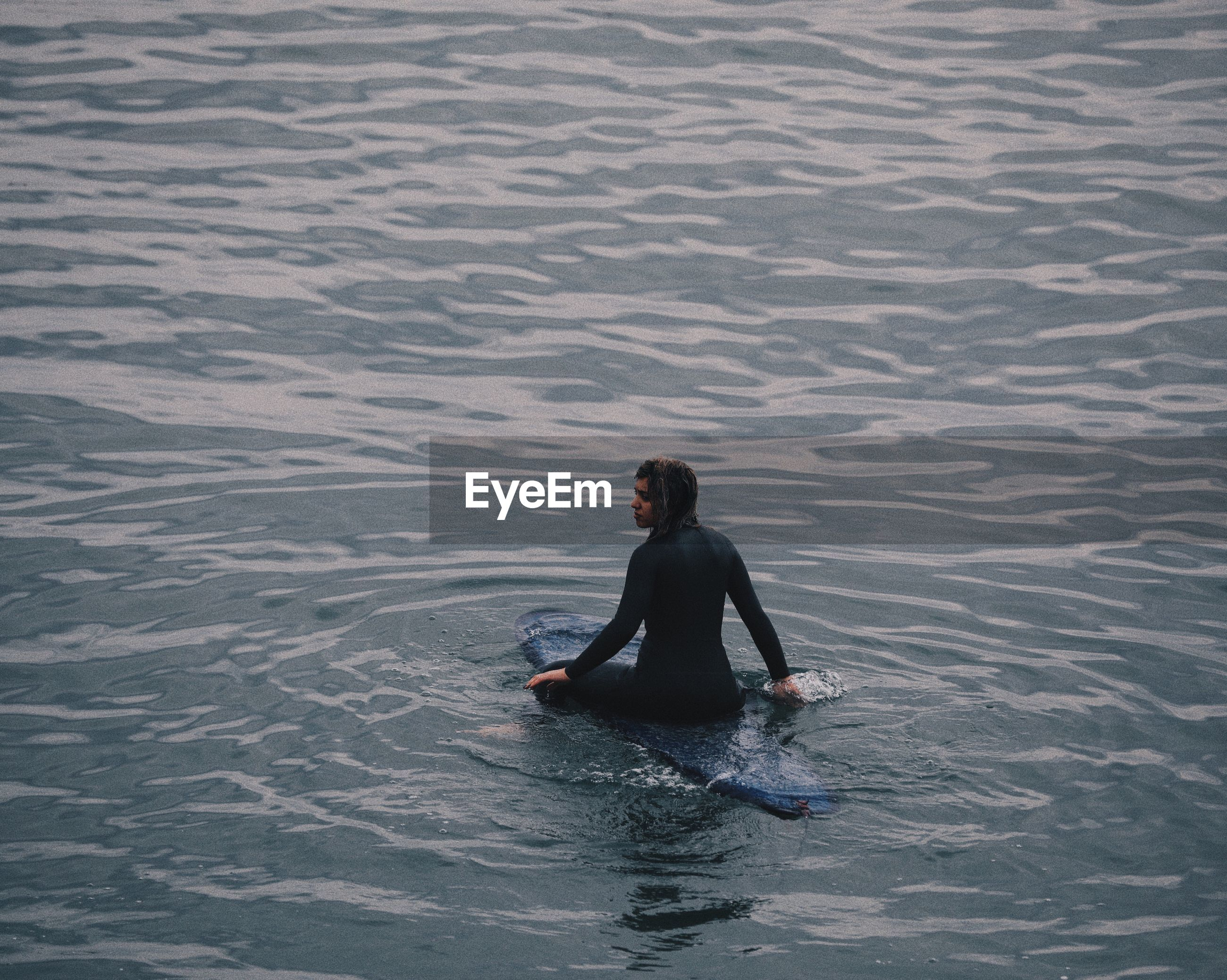 REAR VIEW OF MAN IN SEA