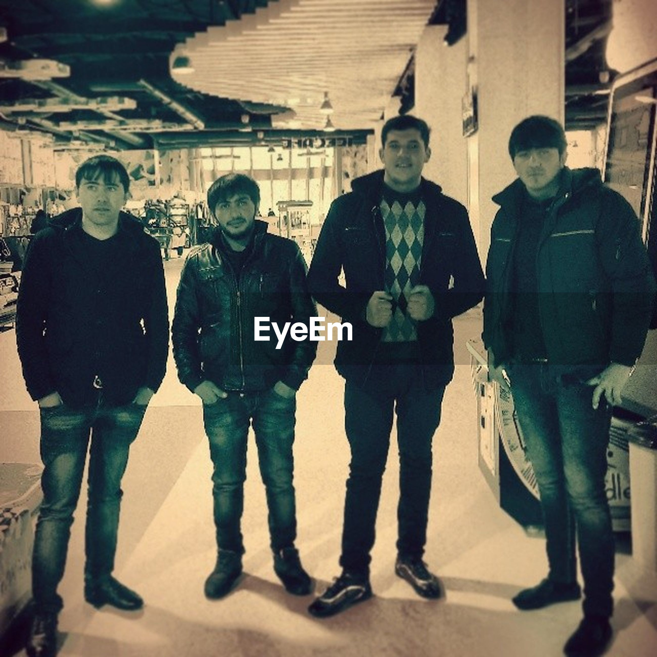 lifestyles, standing, casual clothing, full length, men, leisure activity, togetherness, indoors, walking, front view, young men, rear view, warm clothing, person, friendship, bonding, architecture, day