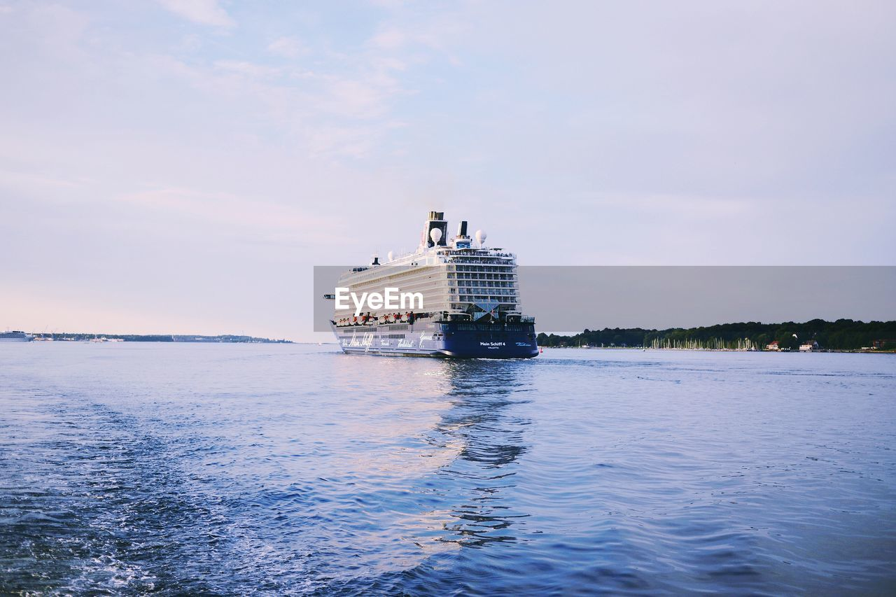 Cruise Ship Sailing In River Against Sky