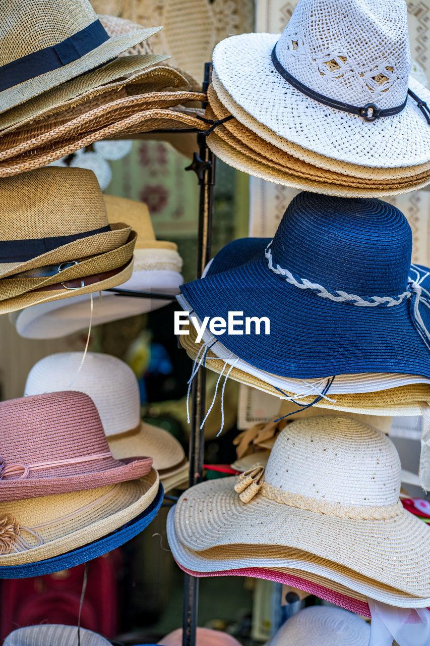 Close-up of sun hats displayed at market stall