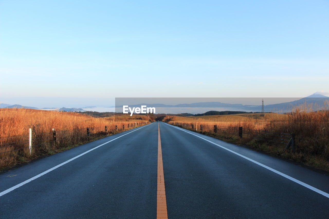 Empty Country Road Against Clear Sky