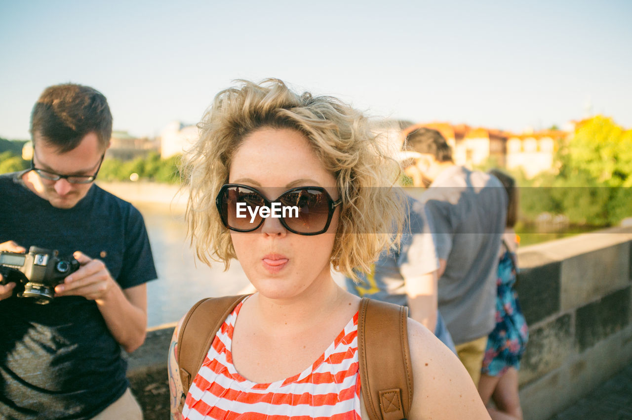 glasses, portrait, real people, lifestyles, headshot, front view, focus on foreground, leisure activity, women, young adult, people, adult, sunglasses, fashion, togetherness, casual clothing, females, young women, day, outdoors, hairstyle