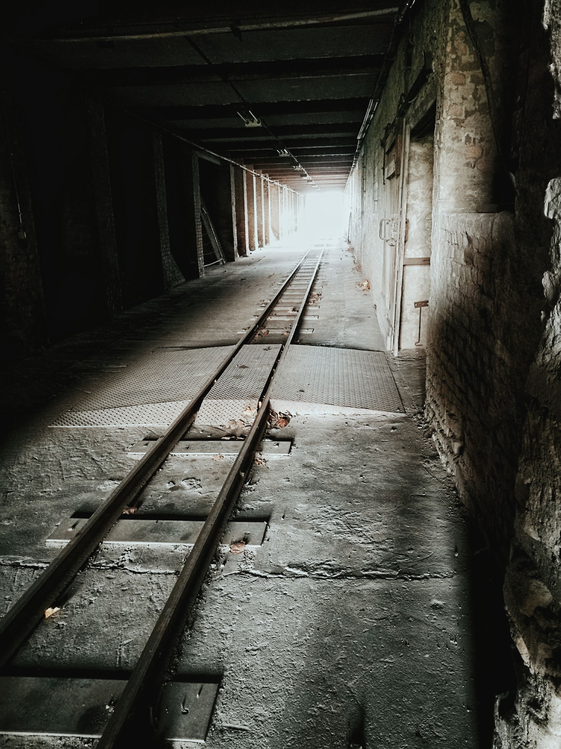 Railroad track amidst tunnel