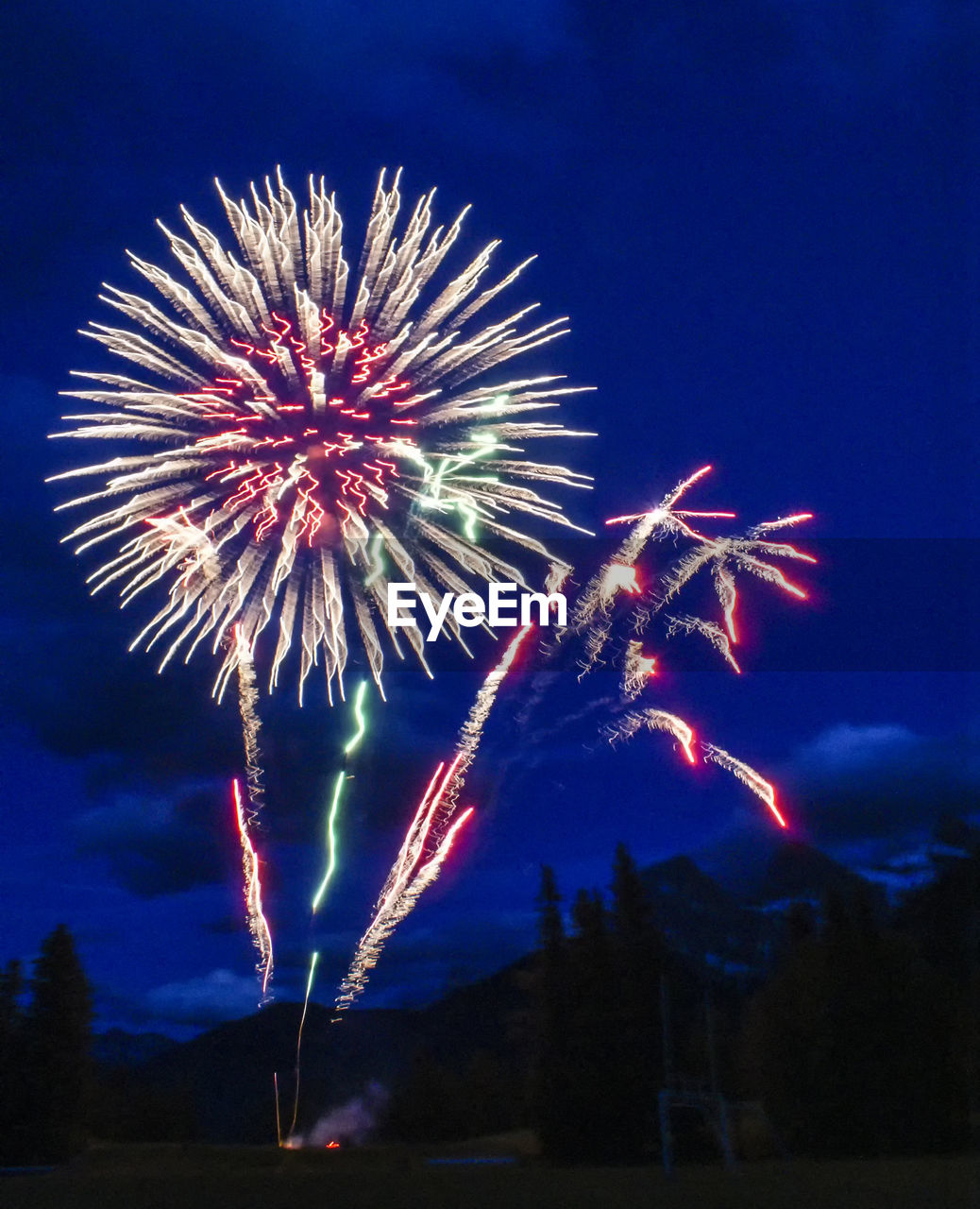 firework, night, sky, celebration, illuminated, motion, firework display, arts culture and entertainment, exploding, event, long exposure, low angle view, nature, glowing, no people, firework - man made object, blurred motion, light, multi colored, outdoors, sparks, explosive