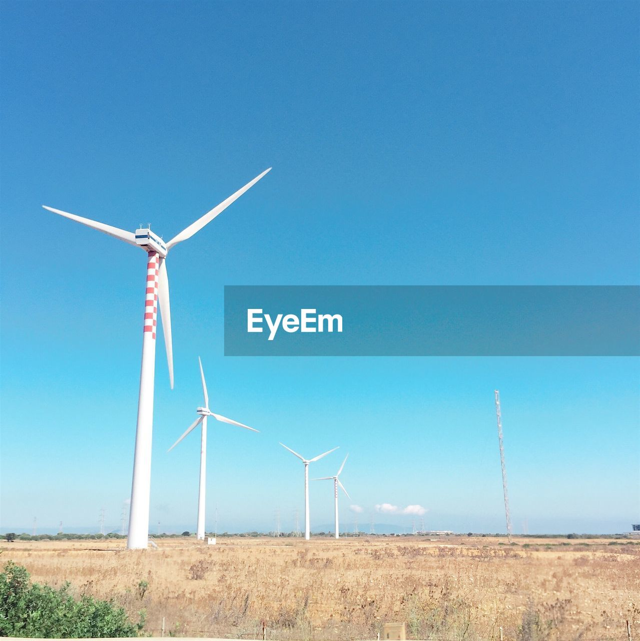 wind power, wind turbine, environmental conservation, alternative energy, renewable energy, fuel and power generation, windmill, field, industrial windmill, blue, day, outdoors, no people, rural scene, clear sky, landscape, nature, grass, sky