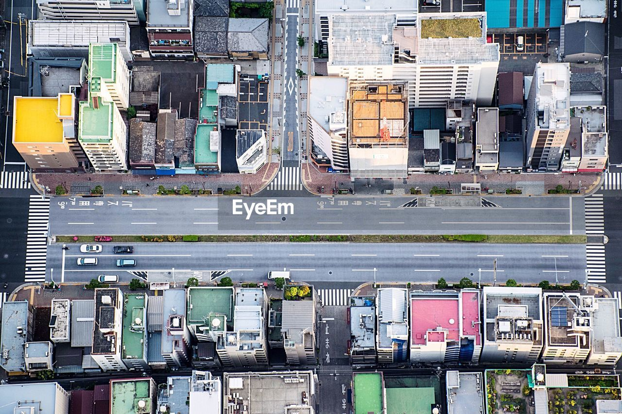 Aerial View Of Street Amidst Buildings In City