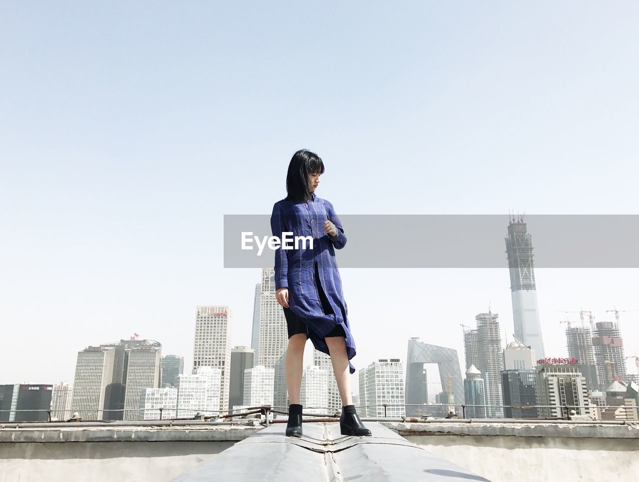 Woman Standing Against Cityscape