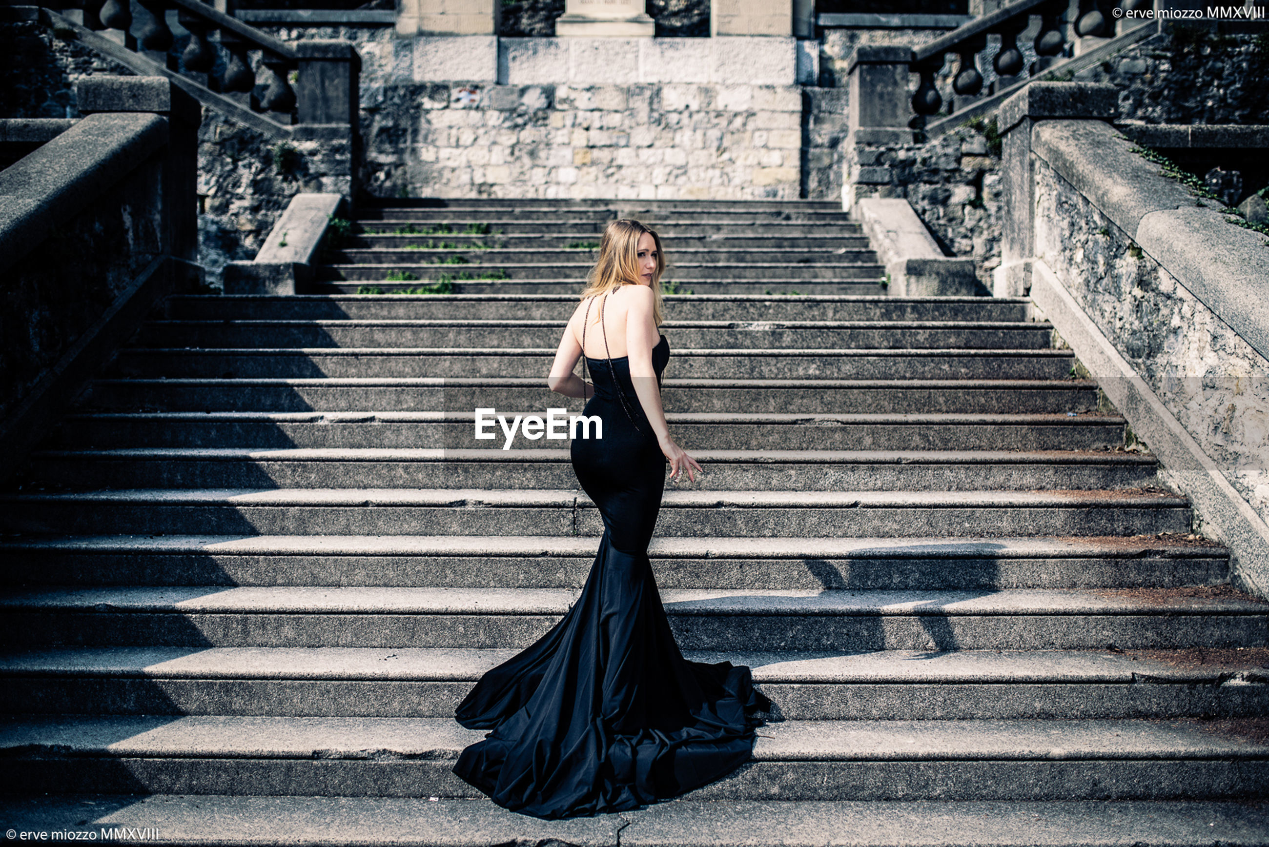 architecture, young adult, one person, staircase, women, clothing, young women, beauty, fashion, full length, adult, steps and staircases, beautiful woman, dress, hair, portrait, formalwear, blond hair, contemplation, hairstyle