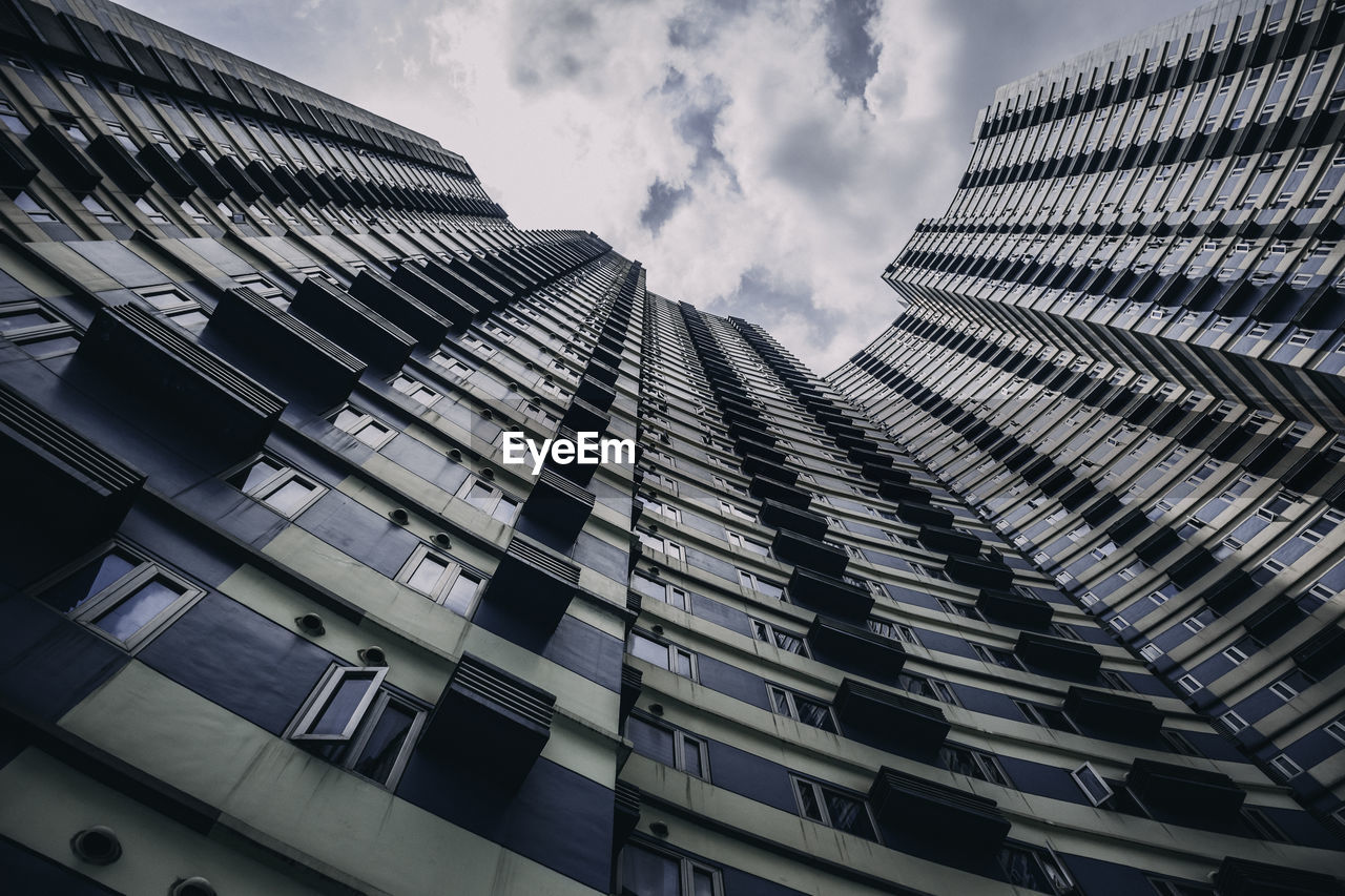 building exterior, architecture, built structure, sky, cloud - sky, building, low angle view, city, no people, office building exterior, tall - high, modern, nature, residential district, day, skyscraper, office, outdoors, window, tower, apartment