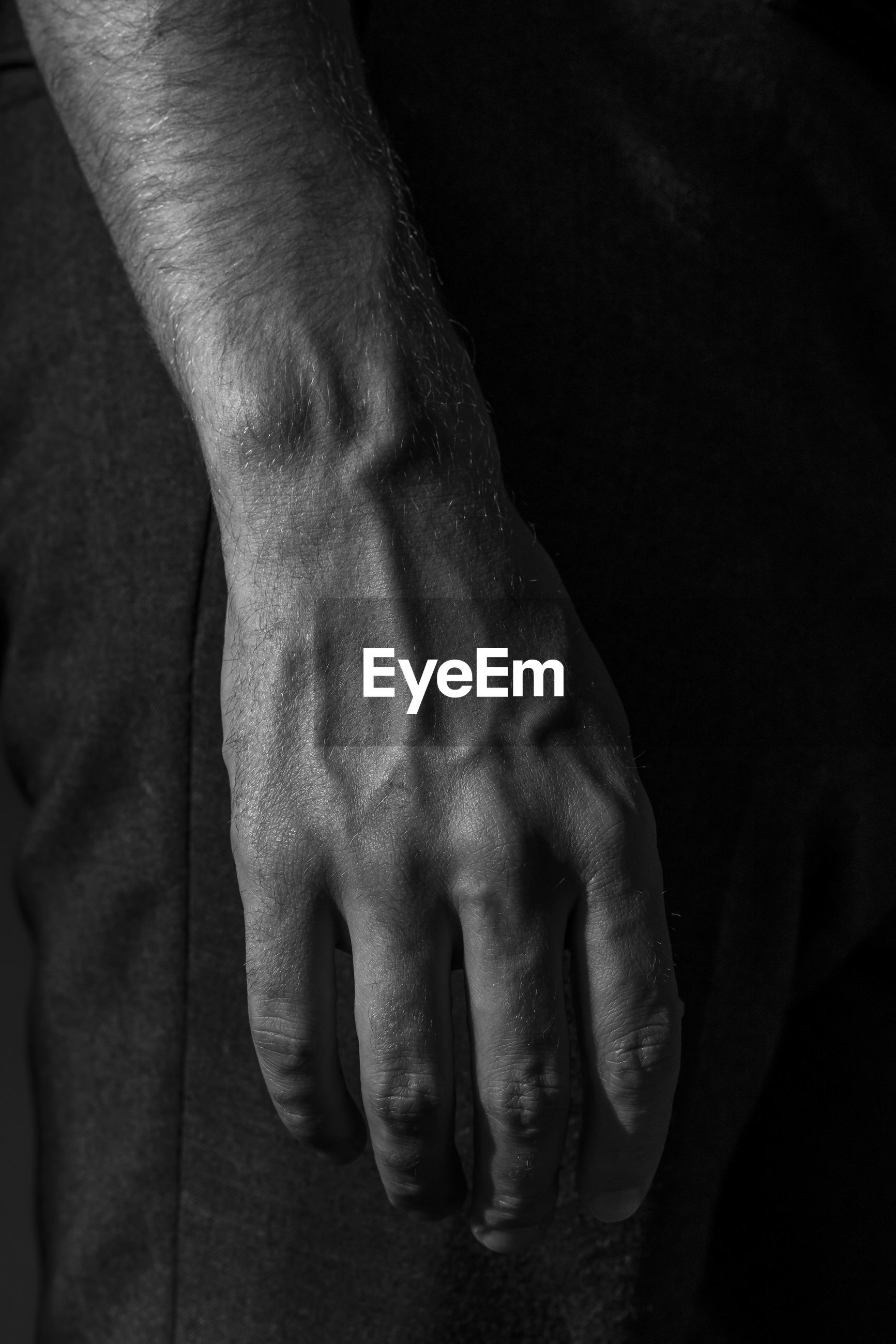 Cropped hand of man in darkroom