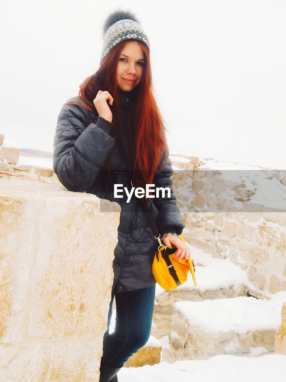 one person, real people, young women, young adult, front view, scarf, casual clothing, standing, leisure activity, winter, full length, outdoors, lifestyles, looking at camera, cold temperature, warm clothing, day, snow, nature, clear sky, beautiful woman, portrait, sky