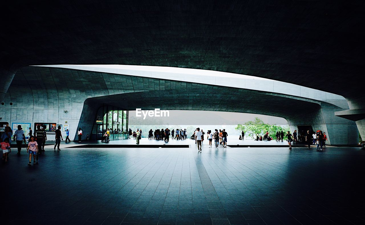 group of people, large group of people, crowd, architecture, real people, built structure, indoors, women, travel, men, lifestyles, adult, illuminated, city, flooring, modern, day, connection, architectural column, ceiling