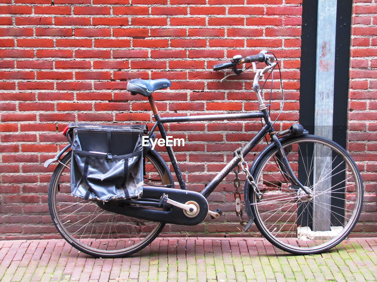 land vehicle, transportation, brick wall, mode of transportation, bicycle, brick, stationary, wall, wall - building feature, day, built structure, architecture, building exterior, no people, red, absence, parking, outdoors, footpath, scooter, wheel