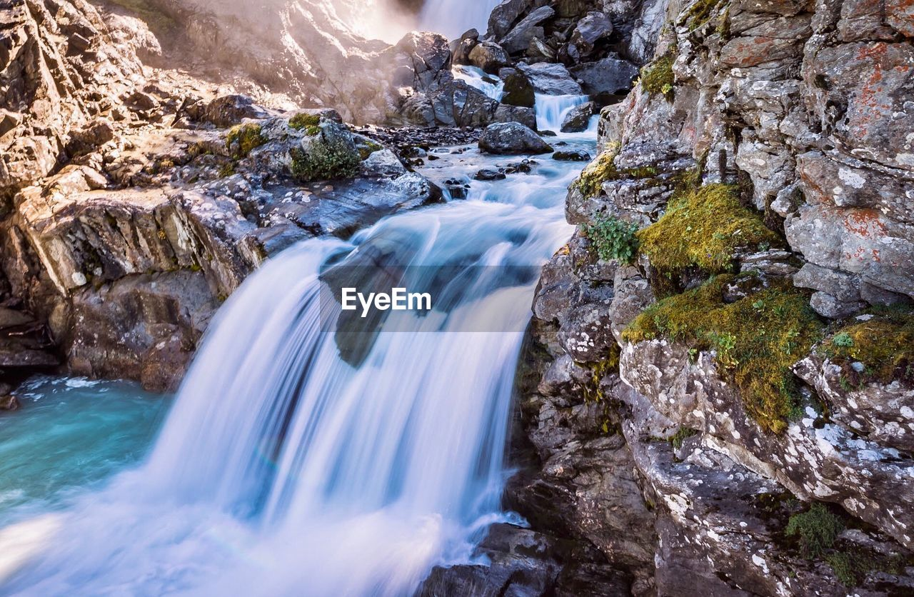 motion, water, rock, rock - object, long exposure, scenics - nature, solid, beauty in nature, blurred motion, flowing water, waterfall, nature, sport, flowing, environment, river, power in nature, power, rock formation, stream - flowing water, outdoors, no people, falling water, formation