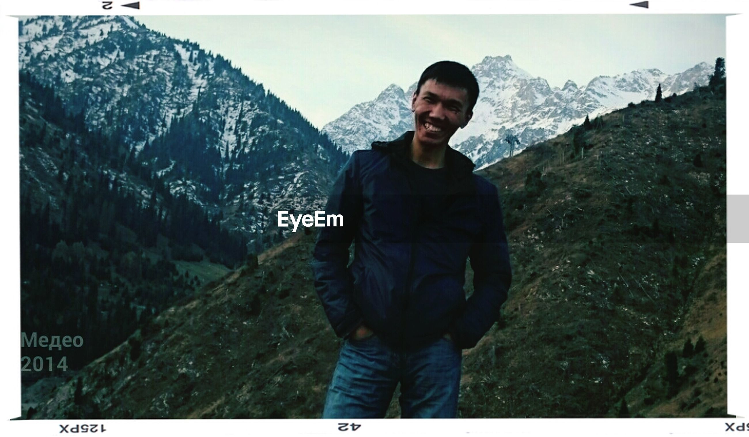 transfer print, mountain, lifestyles, leisure activity, casual clothing, standing, auto post production filter, young adult, young men, mountain range, three quarter length, full length, person, rock - object, day, nature, sky, men