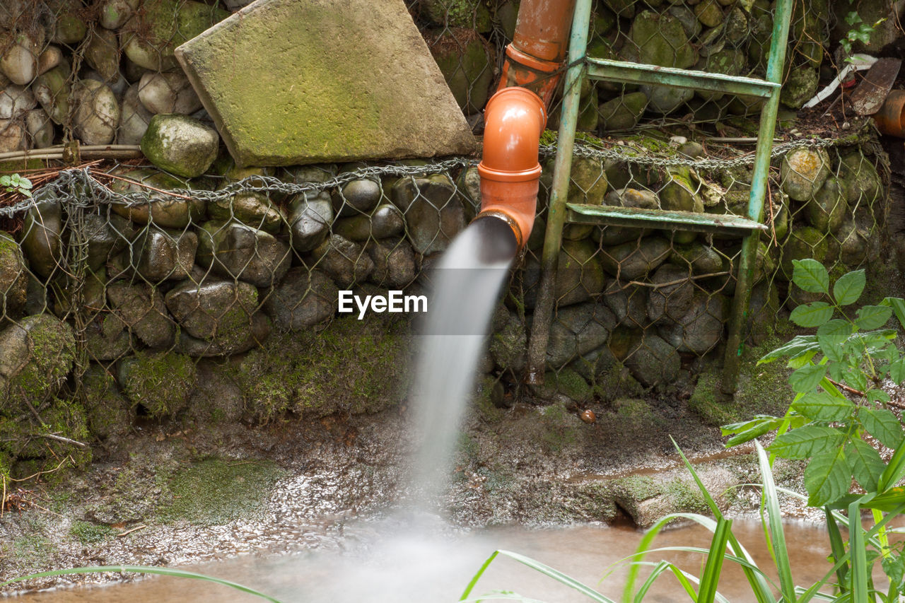 motion, water, pipe - tube, long exposure, day, outdoors, no people, nature, waterfall, running water, spraying, watermill, irrigation equipment, freshness