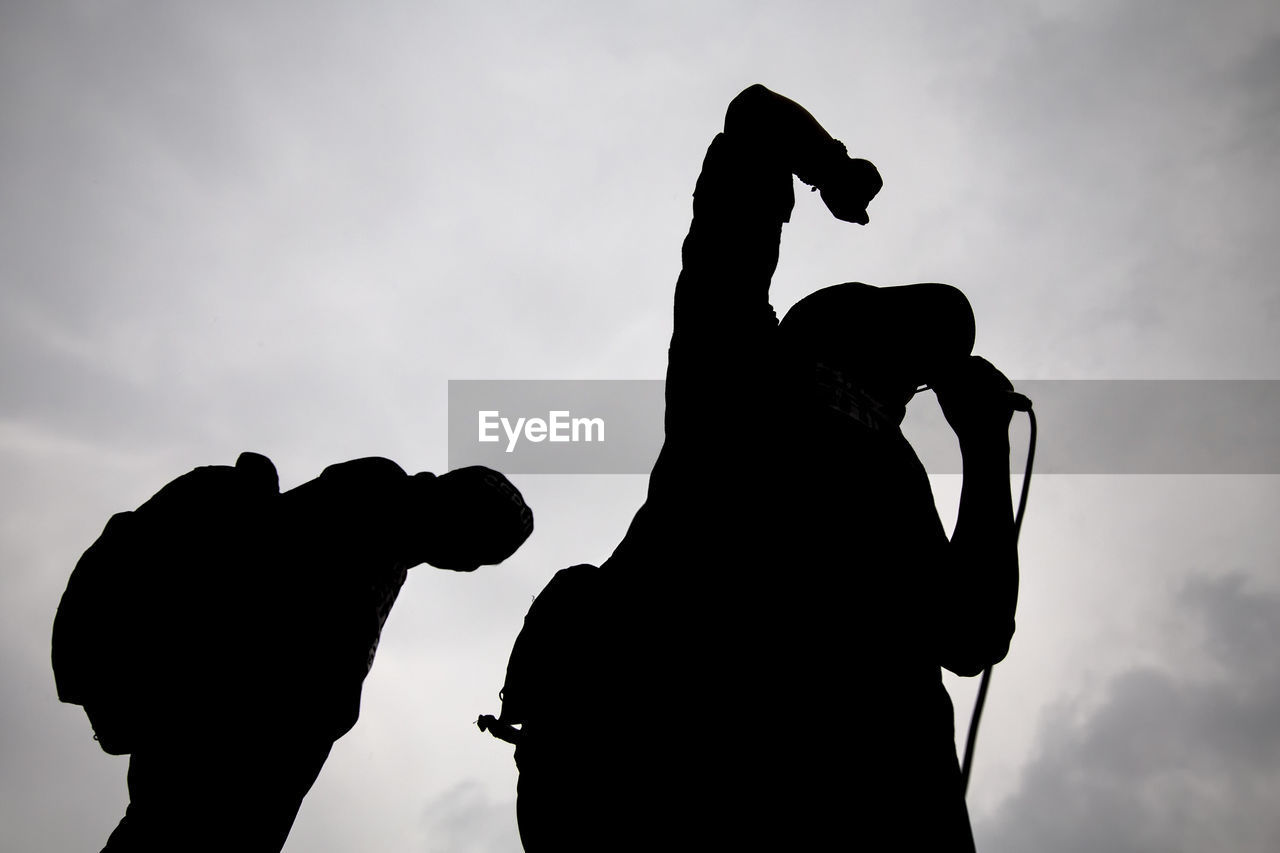 Low Angle View Of Silhouette Public Speaker Giving Speech Against Sky