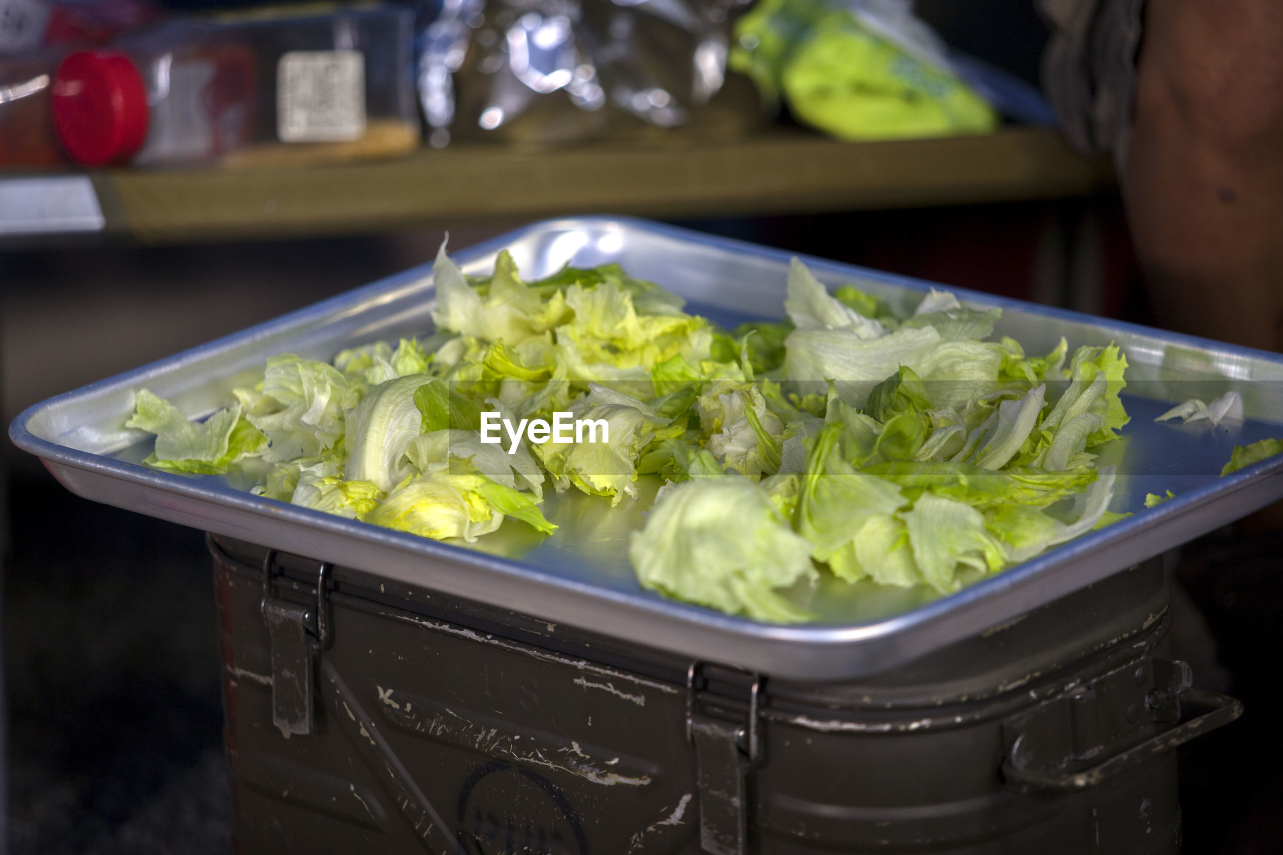 Close-up of lettuce in tray on container at yard