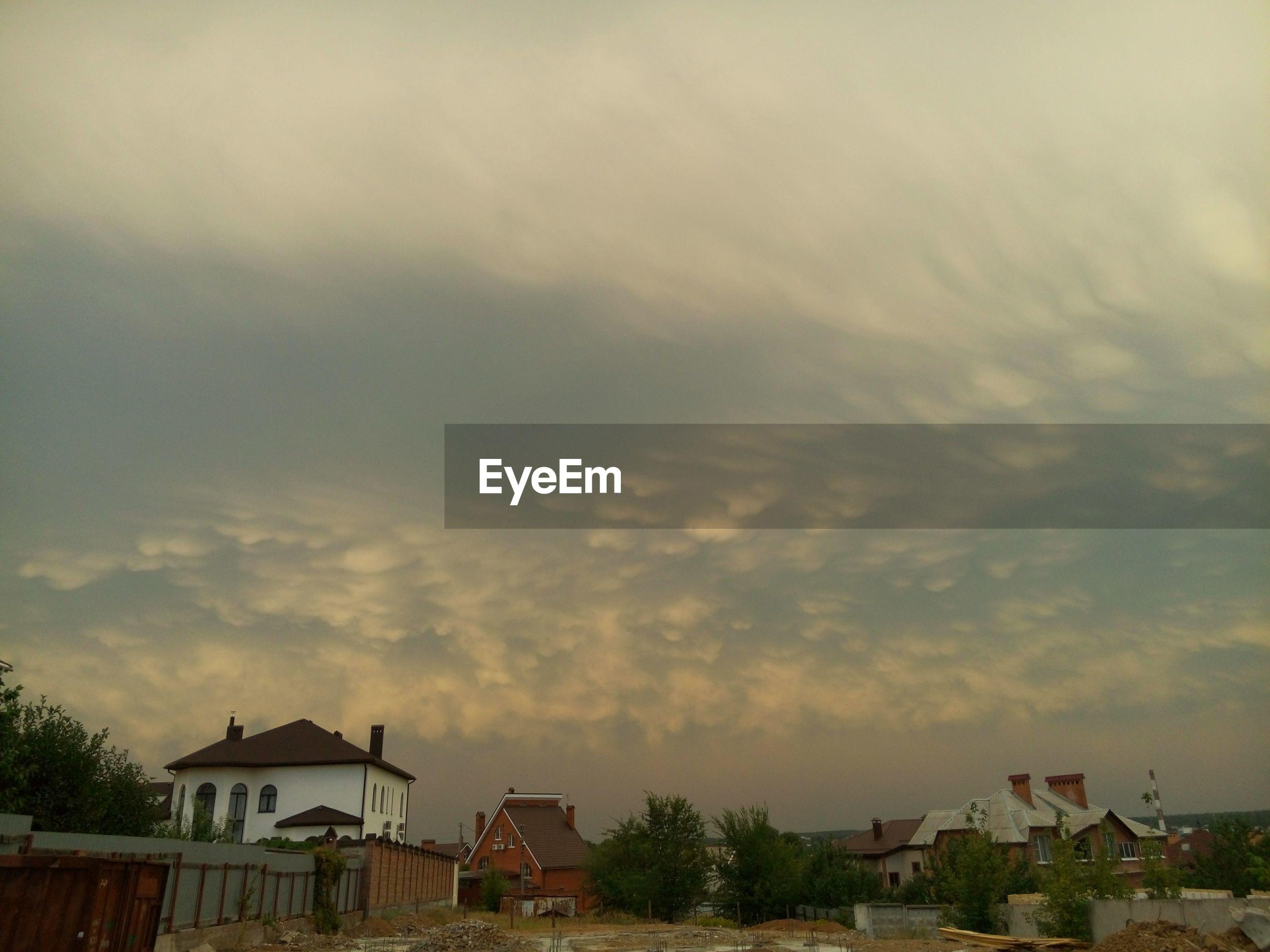 HOUSE AGAINST SKY AT DUSK