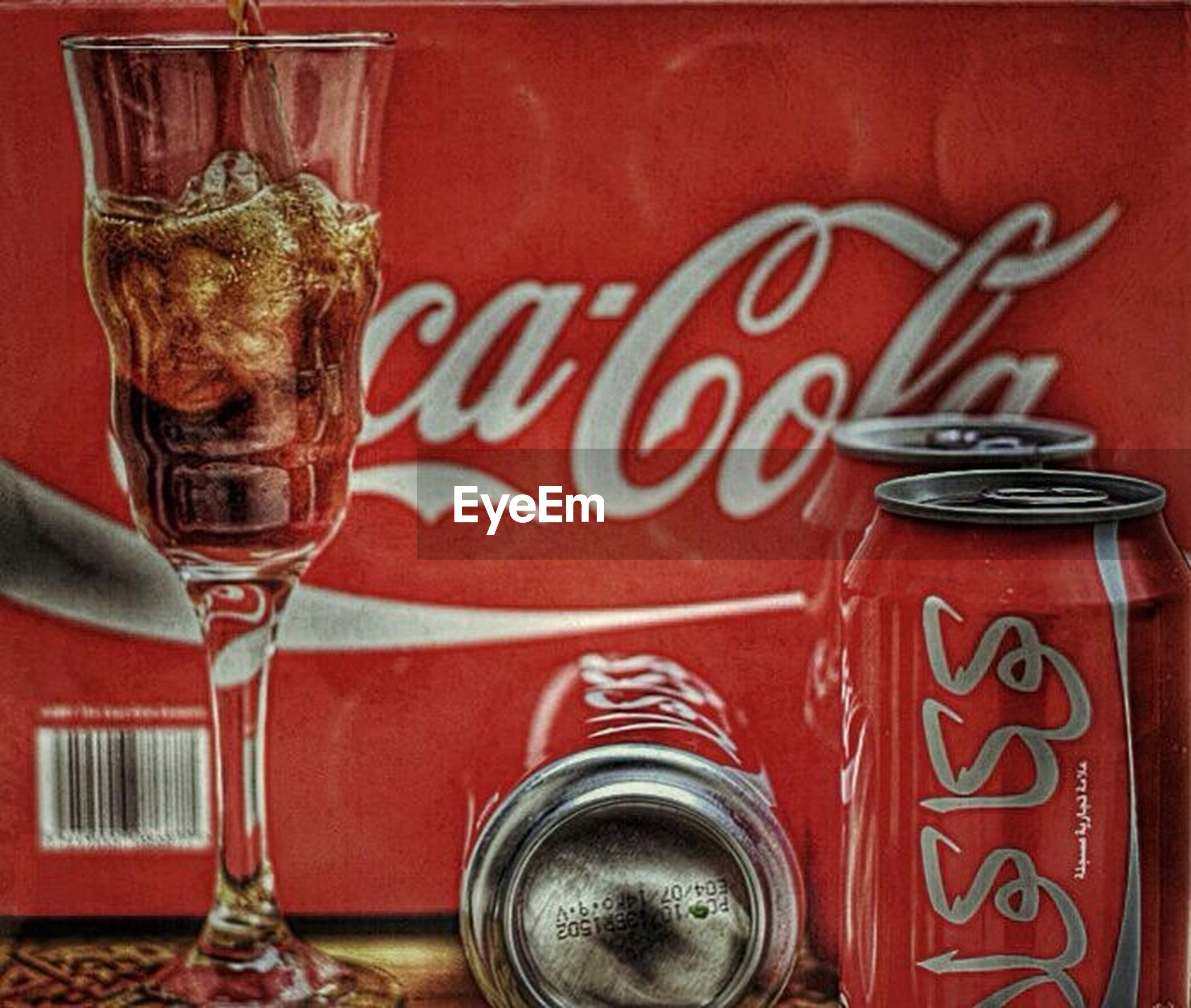 red, close-up, indoors, text, western script, food and drink, drink, glass - material, still life, communication, focus on foreground, no people, transparent, jar, container, metal, wall - building feature, day, refreshment, table