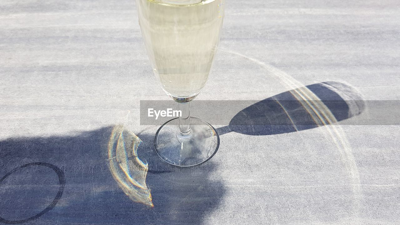 GLASS OF WATER ON TABLE AT DRINKING GLASSES