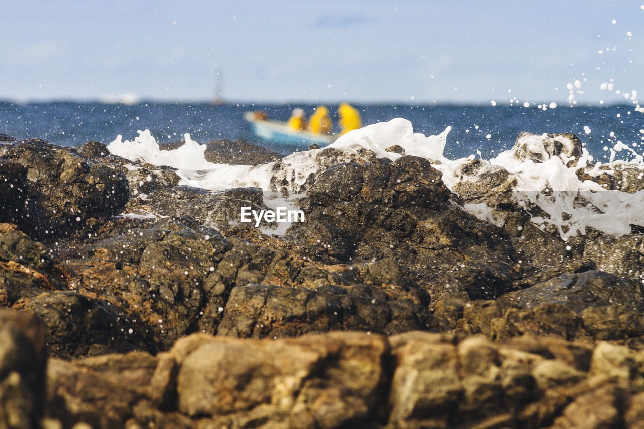 water, sea, nature, rock, motion, no people, splashing, beach, day, solid, beauty in nature, rock - object, close-up, outdoors, selective focus, wave, aquatic sport, sport, power in nature, breaking, flowing water