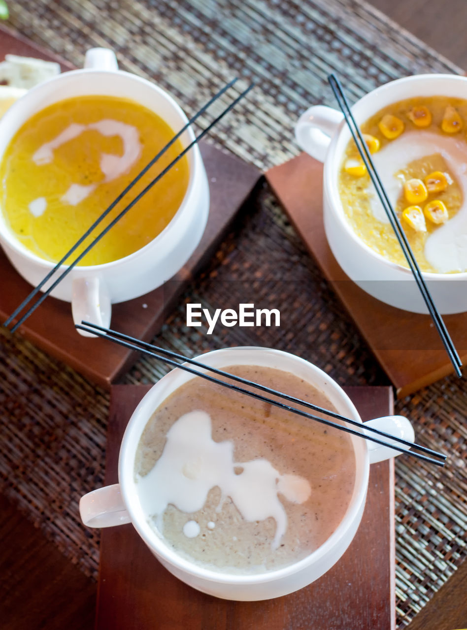 food and drink, drink, kitchen utensil, refreshment, eating utensil, food, spoon, table, still life, coffee - drink, coffee, freshness, cup, ready-to-eat, high angle view, coffee cup, mug, indoors, dairy product, bowl, no people, meal, frothy drink, breakfast, glass, temptation, latte