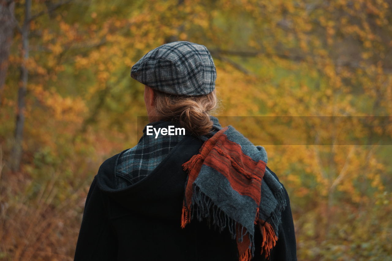 Rear View Of Man Wearing Warm Clothing During Autumn
