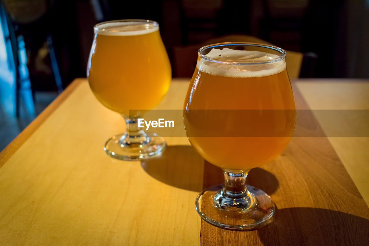 Close-up of beer in glasses on table