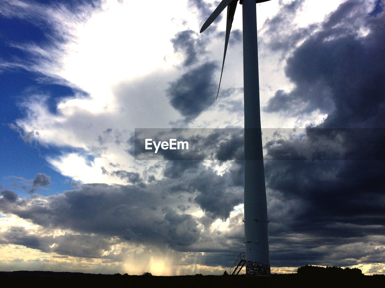 sky, cloud - sky, low angle view, no people, outdoors, day, silhouette, nature, sunlight, beauty in nature, industrial windmill