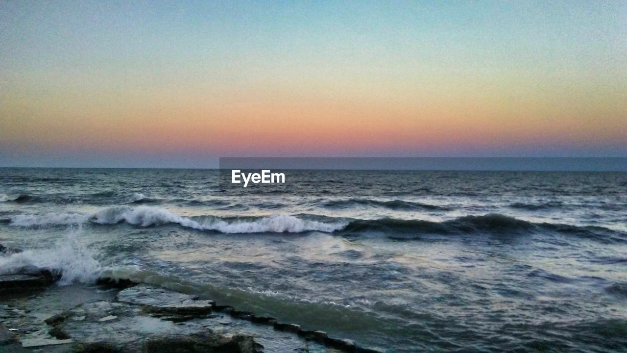 sea, horizon over water, water, beauty in nature, nature, scenics, wave, sunset, sky, tranquil scene, idyllic, motion, tranquility, no people, clear sky, beach, outdoors, power in nature, day